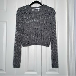 Cropped loose knit sweater with silver thread